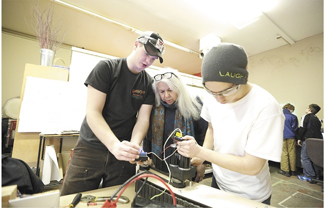 Students prep for the FIRST Robotics Competition later this spring with the help of Gizmo CDA co-founder Barbara Mueller. - YOUNG KWAK