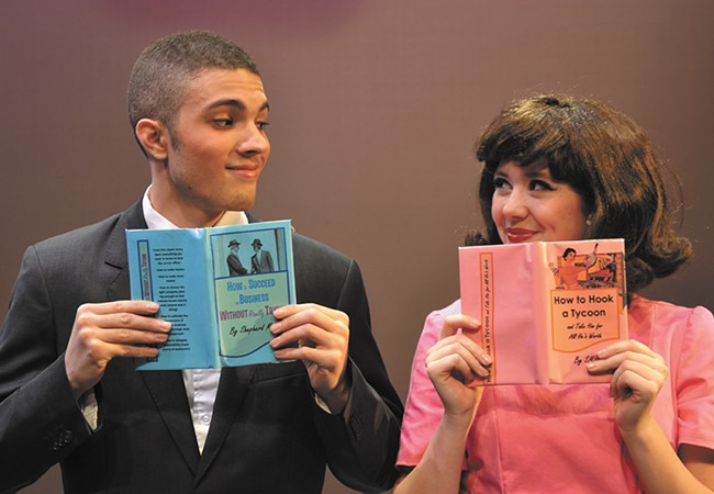 Ilan Hernandez (left) as J. Pierpont Finch and Julian Lee as Rosemary Pilkington.