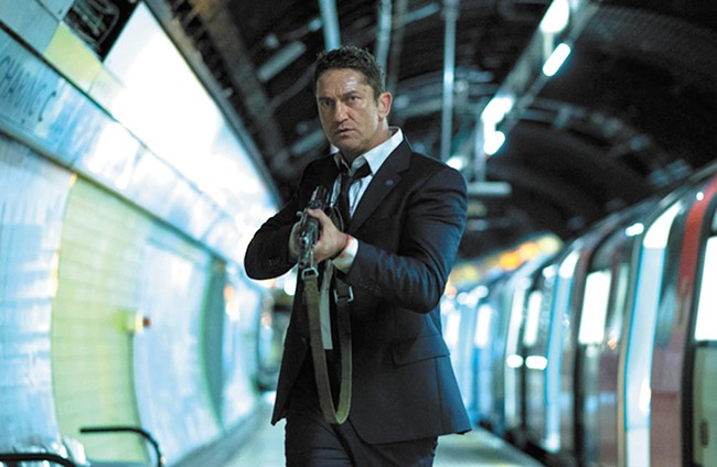 Gerard Butler fires away, but misses.