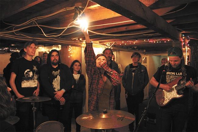 Bayou tenant Allyson Amstutz (center) turns off the basement light for Spokane band Deformer last weekend. - LAURA JOHNSON