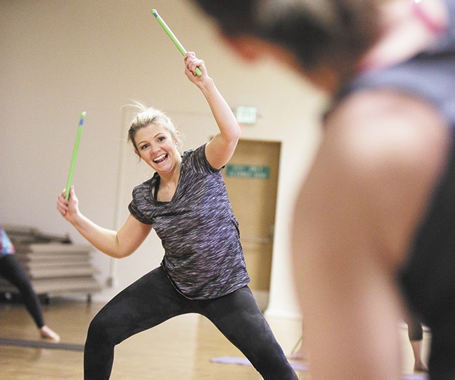 Nicole Baldwin's drumsticks fly during a POUND Pro class in Cheney. - YOUNG KWAK