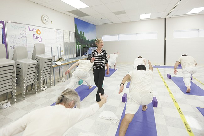 Volunteer Diane Sherman leads a yoga class for inmates at Airway Heights Corrections Center. - YOUNG KWAK