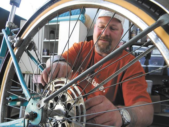 Dan Jackman, a mechanic at Mosaic Community Bike Shop. - JAKE THOMAS