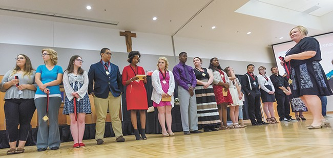 """Students from Rogers and North Central high schools celebrated at a """"First in the Family"""" ceremony for kids who are first in their families to graduate and go to college. - JEFF FERGUSON"""