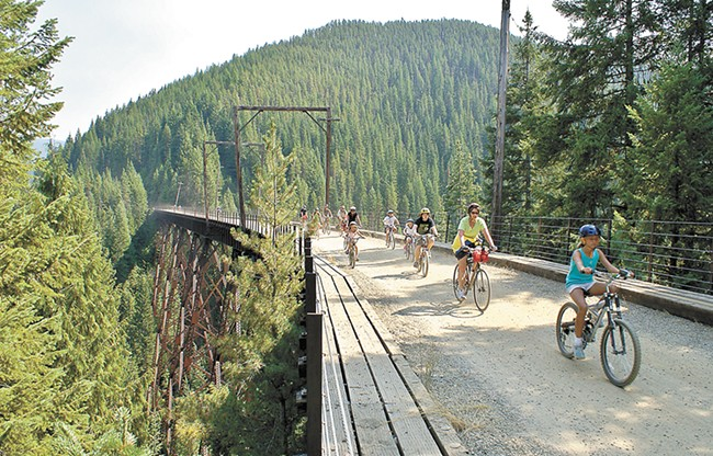 The Hiawatha Bike Trail runs along a former train track and connects Idaho and Montana.