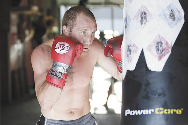 Jacob Szilasi, a welterweight pro boxer based in Spokane, trains in a gym owned by his coach Jesse Mora. - YOUNG KWAK
