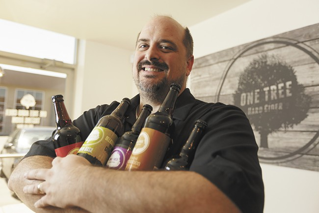 One Tree Hard Cider's Neal Hennessy with several varieties of his company's award-winning cider. - YOUNG KWAK