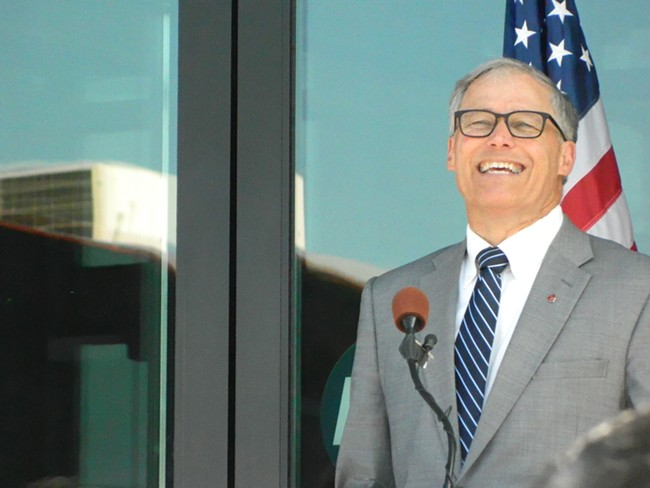 Washington Gov. Jay Inslee had a laugh as oil-train protestors confronted a smiling President Barack Obama at a fundraiser.