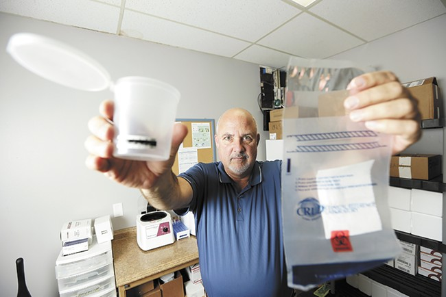 Doug Thayer, owner of a local franchise of ARCpoint Labs, consults businesses on how to protect themselves from employees who show up to work high. He says there's currently no good way to check if an employee is under the influence of cannabis while at work. - YOUNG KWAK