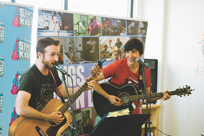 Scott Ingersoll (left) and Miles Martin bring music to the Sacred Heart Children's Hospital every week. - KRISTEN BLACK