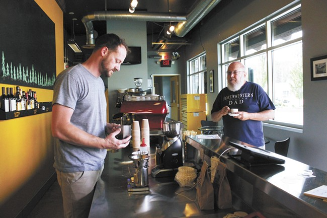 Young Bennett (left) and his wife Michal recently opened Coffee Roboto. - CARRIE SCOZZARO