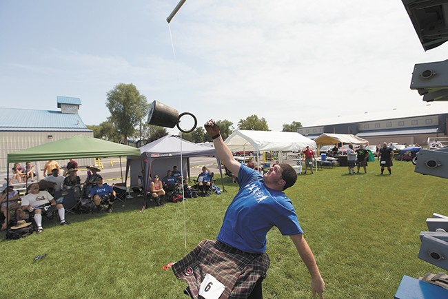 The annual Spokane Highland Games feature a number of traditional Scottish athletic events. - YOUNG KWAK