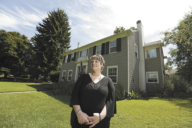 Kimberly Hoskin outside of Miryam's House, a transitional facility in Spokane, where Hoskin lived after undergoing drug treatment. - YOUNG KWAK