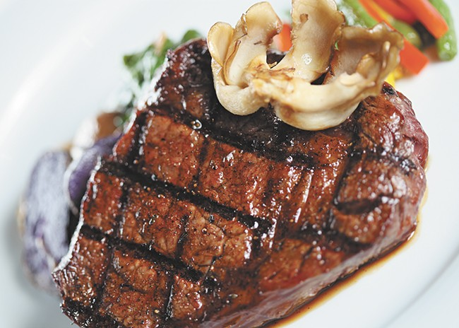 A bison ribeye is perfectly prepared at Masselow's. - YOUNG KWAK