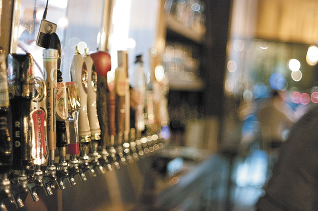 Fifty taps line the bar at Manito Tap House.