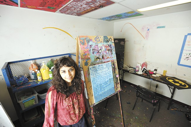 Angelina ended up in The Jungle, Seattle's infamous homeless encampment, where she says she was sold to a man in exchange for drugs. Here she's seen next to a painting she made during her in-patient treatment at Daybreak Youth Services in Spokane. - YOUNG KWAK