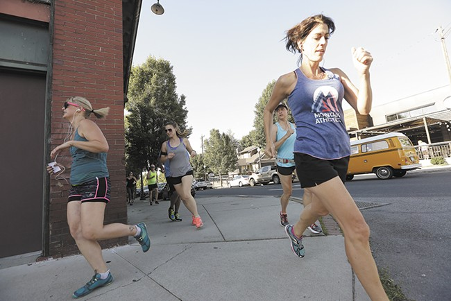 Runners with the Lantern Tap House club take to South Perry. - YOUNG KWAK