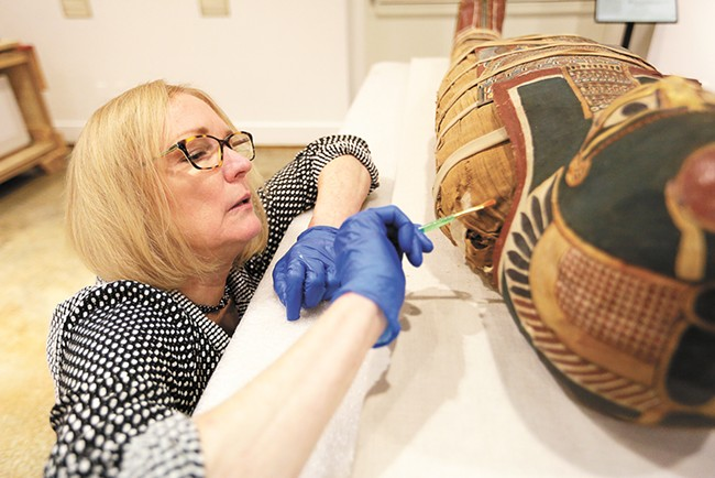 Conservator Mimi Leveque restored Annie's mummified remains in 2009 so she could be featured in the exhibit. - YOUNG KWAK