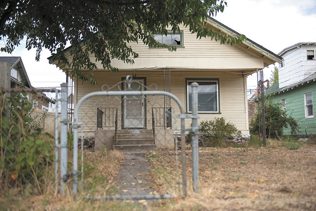 This Bridge Avenue property, owned by the city of Spokane's Chief Financial officer Gavin Cooley, has sat vacant for eight years, as Cooley has struggled to figure out how to deal with it. - DEREK HARRISON