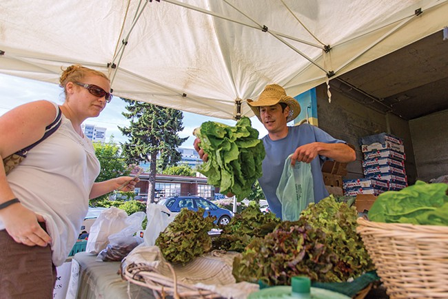 Joe Piver of Tolstoy Farms sells local lettuce at the Spokane Farmers Market. - MATT WEIGAND