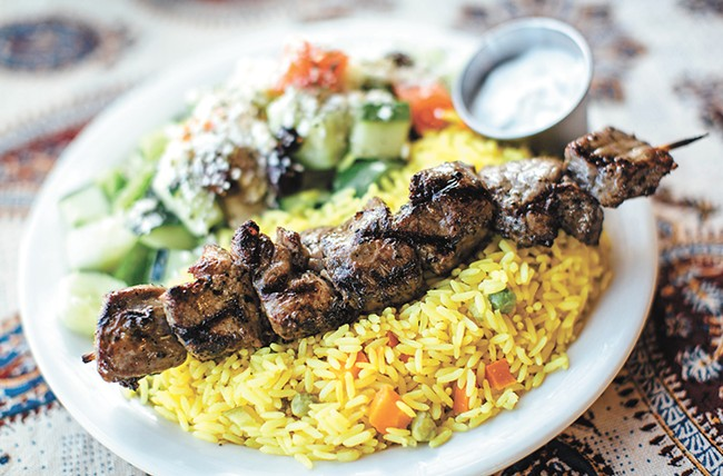 Marinated beef with rice and Greek salad at the Kabob House. - JENNIFER DEBARROS