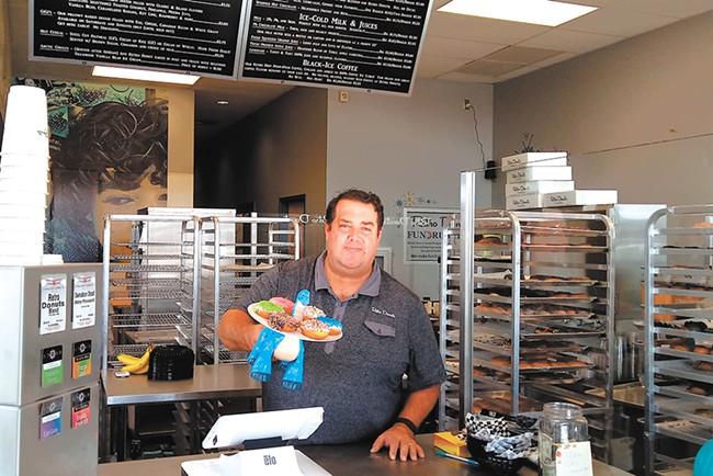 Jon Fine at the recently opened Retro Donuts. - DAN NAILEN