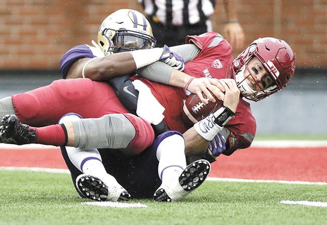 WSU quarterback couldn't get rolling against UW's defense. - YOUNG KWAK