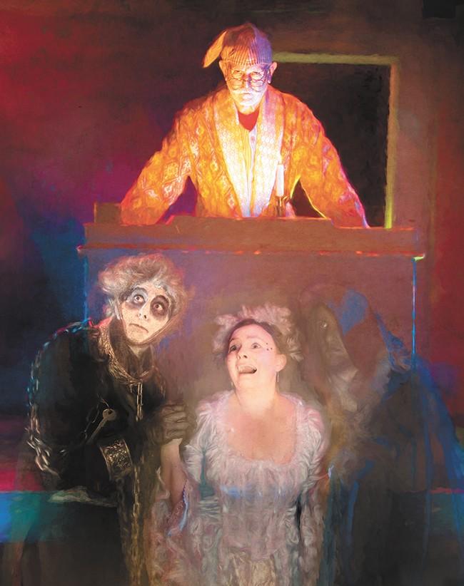 Ron Weeks as Scrooge; Blake King-Krueger as Marley (left), Emily Geddes as the Ghost of Christmas Past and Tim Linton as the Ghost of Christmas Future (right). - CHRIS WOOLEY