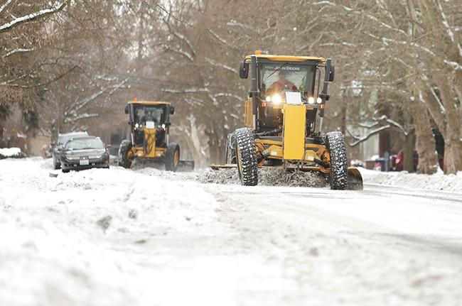 Snow plows clean up Spokane's Browne's Addition neighborhood last week. | Young Kwak photo