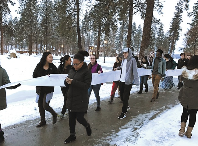 """Whitworth students march to the university president's office with a petition to declare the school a """"sanctuary campus."""""""