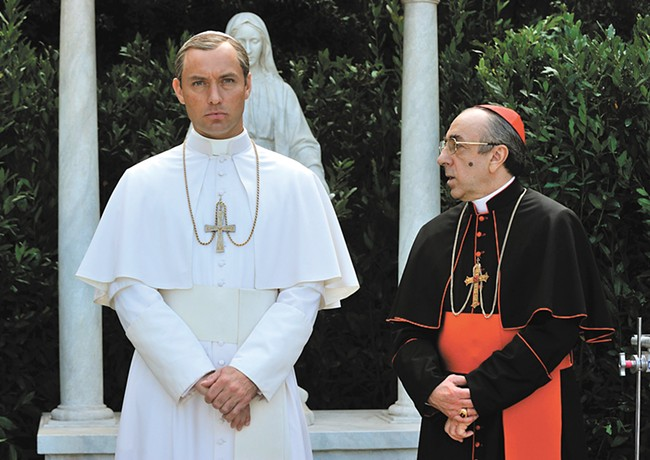 Jude Law plays a narcissistic new pope who's rattling the cages of old Cardinals, like the one played here by Silvio Orlando. - GIANNI FIORITO/HBO PHOTO
