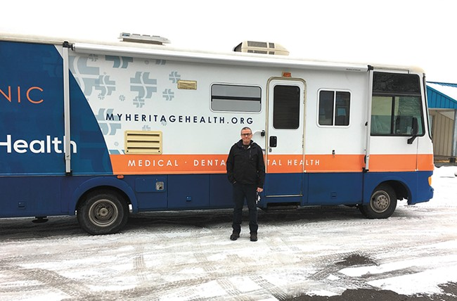 TJ Byrne and the Heritage Health mobile clinic. - MITCH RYALS