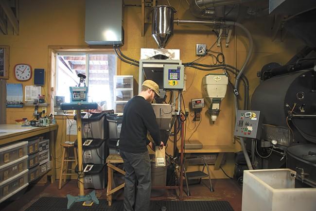 Chris Malberg fills a bag with freshly roasted beans at Landgrove Coffee roasters in Troy, Idaho. - TARYN PHANEUF