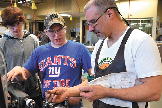 Teacher Tony Anselmo (right) gives Wyatt Harrison some pointers. - WILSON CRISCIONE