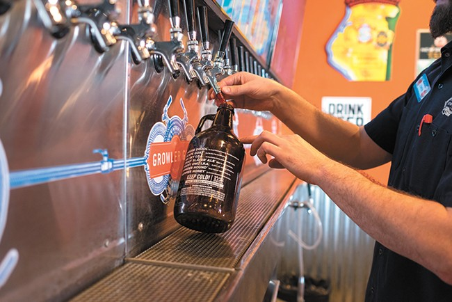 Fill 'er up at one of Growler Guys' locations. - HECTOR AIZON