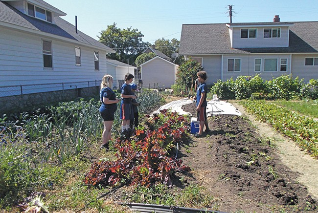 Project Hope kids work in a garden at Boone and A Street, in the summer of 2016.