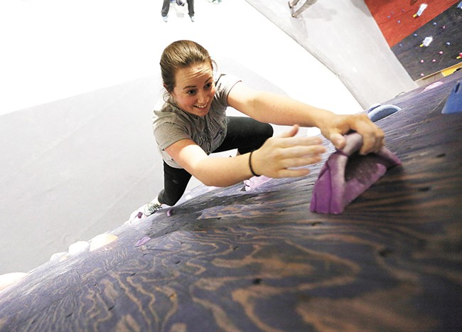 Katie Rykken is among the first to try out Spokane's newest climbing gym. - YOUNG KWAK