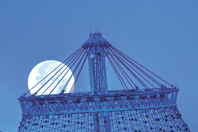 """A photo from the series """"Moon Over Spokane"""" by Pat Schilling"""