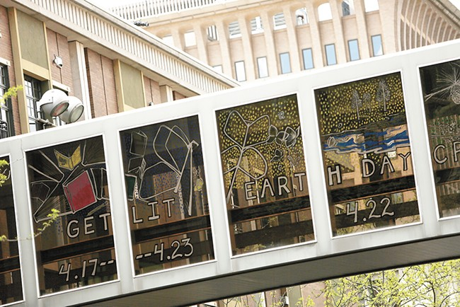 Artist Mallory Ware sprinkles familiar Spokane landmarks in a skywalk that stretches across Main Avenue. - YOUNG KWAK