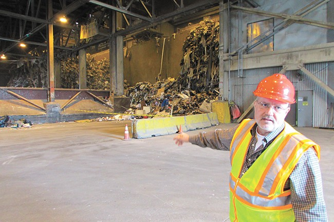 Solid Waste Disposal Director Chuck Conklin inside the Waste-To-Energy plant. - DANIEL WALTERS
