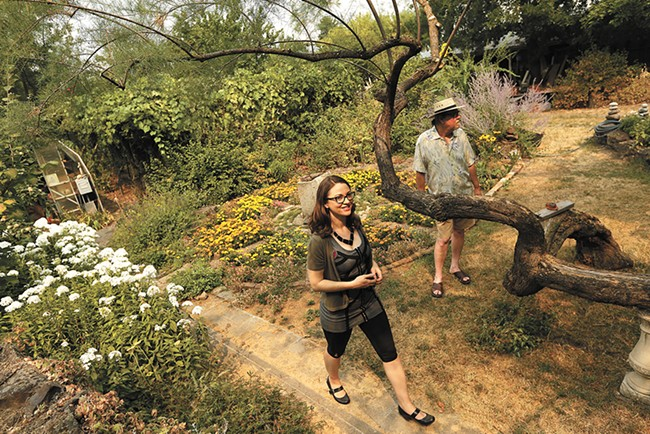 Mariah McKay and Chris Nerison stand in the garden they hope to tend as neighbors in a new community they're planning. - YOUNG KWAK