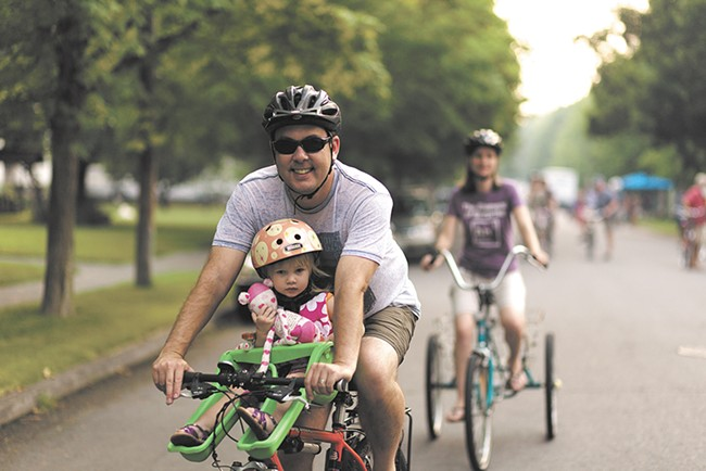 Rob Brewer and his daughter Winnie ride during Summer Parkways. - YOUNG KWAK