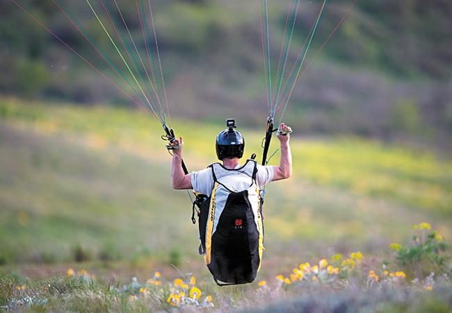 Kevin Chaupman of Spokane paraglides near Steptoe Butte. - RH MILLER