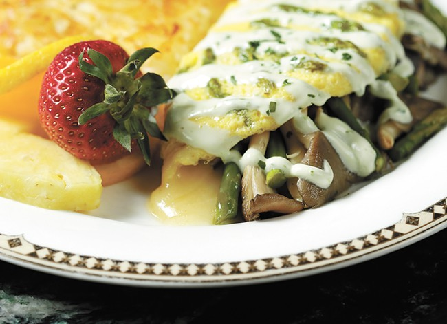 A forest mushroom and asparagus omelet from the Palm Court Grill. - YOUNG KWAK