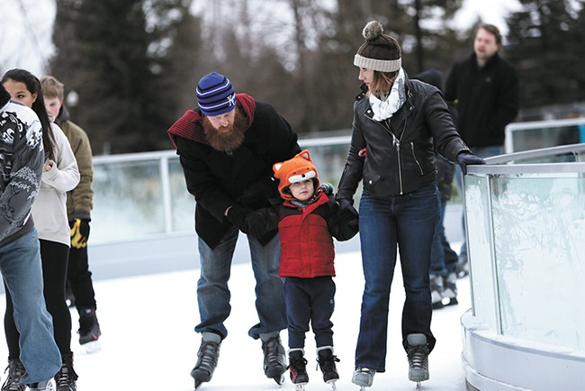 First Night Spokane attendees can enjoy free skating at Riverfront Park's new ice ribbon. - YOUNG KWAK
