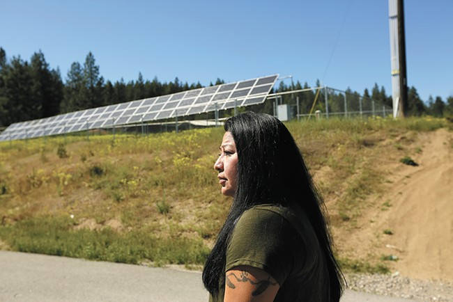 The Spokane Tribe's Planning Manager Maria Cullooyah, in front of new solar panels in Wellpinit, Wash. - YOUNG KWAK