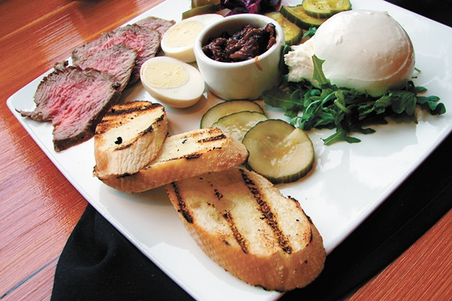 The beef and burrata plate, served with baguette, caramelized onion and tomato jam and pickled veggies. - CARRIE SCOZZARO