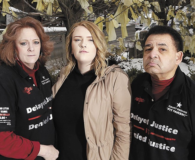 Ron and Teresa Simon, pictured here with Teresa's daughter Megan, have been fighting to get their son back since 2015. - YOUNG KWAK