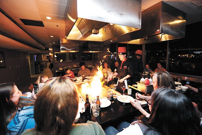 Diners are seated communally at Kobe's three hibachi tables. - YOUNG KWAK