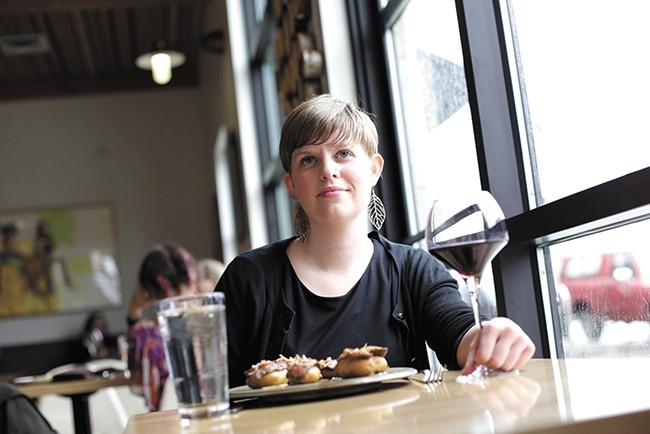 Writer Cara Strickland enjoys a meal and glass of wine solo at the Wandering Table. - YOUNG KWAK